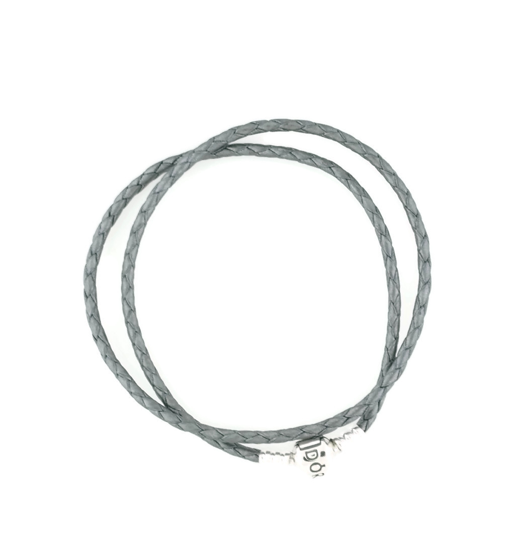 Embody pure casual luxury with this shimmering Silver Grey Leather Bracelet  from Pandora. The magic of nature awakens as Pandora celebrates new  beginnings. f58adf5cecb